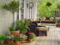 house-porch-design-with-plant-pots-and-furniture-and-swing-bench