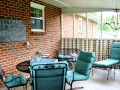 living-room-lounge-simple-screened-in-porch-makeover-with-green-chair-and-table-with-brick-wall-indoor-screened-in-porch-furniture-arrangements-ideas-screened-porch-diy-screened-porch-on-existing